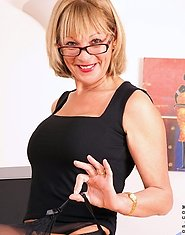 Horny cougar milf Elaine let out her naughty side as she strips off during office work