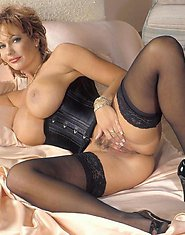 Hot granny in black shows off her snatch