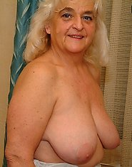 Big titted granny showing off her body