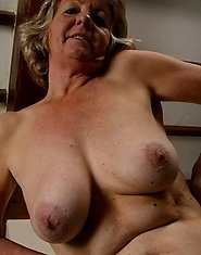 Mature BBW getting naked and posing