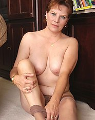 Lascivious mature chick in silky pantyhose spreading her legs in a trice