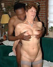 Curly haired milf with huge natural tits fucks a giant black dong