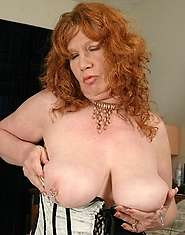 Ginger granny and her favorite dildo