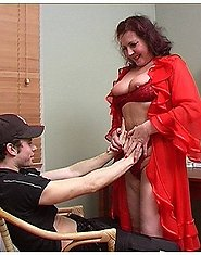 A young boy is fucking a mature brunette in red underwear