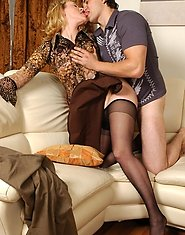 Naughty mature clad in barely black pantyhose getting screwed on the sofa