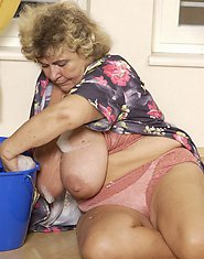 Nasty granny got a really huge tits to lick
