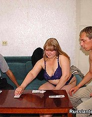 Two guys and a busty plump blonde play cards nude