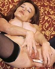 Tattooed granny loves fingering her slit