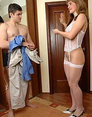 Horny milf in white nylons and matching corset getting done by a hung guy