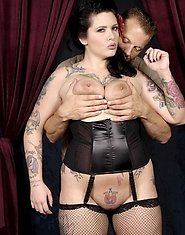 What starts out as a sultry photo op soon turns even sexier. Madison Mitchell shows off a inked up body so irresistible beneath her lacy corset that e