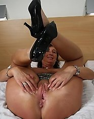 This horny cougar gets wet on her bed