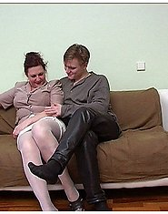 A horny mature brunette in white stockings is fucked by a younger guy