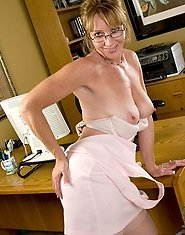 Naughty secretary peels off her clothes and pleasures her milf pussy with a vibrator