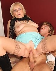 The beautiful granny with the dripping wet old pussy is fucked by his throbbing cock