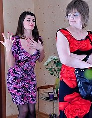Dolled-up milf and girl take time for tongue kisses and all-girl dildo play