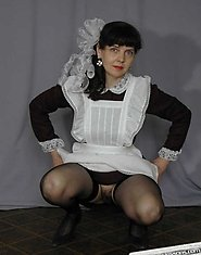 A horny mom in black stockings demonstrates school uniform